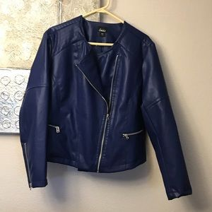 Blue jacket with zipper detail.